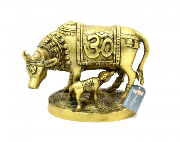 Om & Swastika Engraved Kamdhenu Cow Brass Showpiece